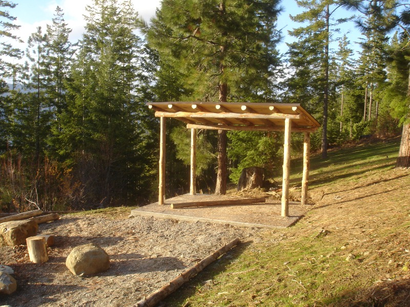 The log woodshed... made from Craig Land Timber...